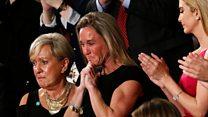 Navy widow weeps as Trump pays tribute