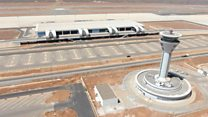 Why is Dakar's new airport 50km away?