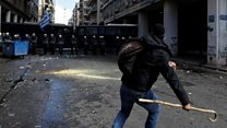 Greek farmers attack police with crooks