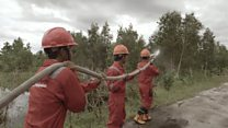 Damping down to fight peatland fires