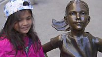 Fearless Girl faces Wall Street bull