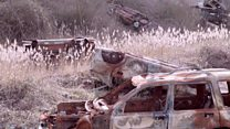 Chalkpit graveyard of burnt-out cars