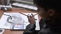 Meet migrant boy dubbed 'Little Picasso'