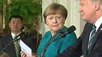 Merkel handshake offer falls on deaf ears