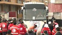 خروج مقاتلي المعارضة وعائلاتهم من حي الوعر في حمص