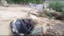 Man escapes after floodwaters flip car