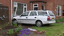 Stolen car crashes into house