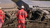 Engineers assess derailed freight train