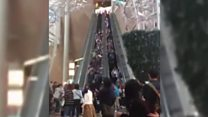 Escalator malfunction injures dozens