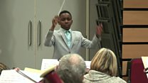 Young conductor on music mission