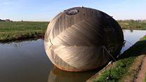 Inside a giant wooden floating egg