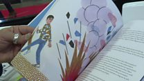 معرض للكتاب في إيطاليا يحاول شرح قضية الهجرة للأطفال