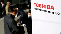 Why is behind Toshiba's financial crisis?