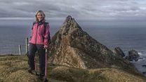 Bone cancer survivor climbs mountain on crutches