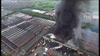 Aerial shots of massive warehouse fire