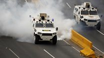 Tear gas and water cannon at Caracas protest