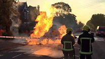 Fire erupts from road as gas main leaks