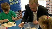 Tim Farron 'squidges' dough at school