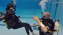 Diving brings happiness to paralysed son