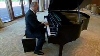 Putin plays piano ahead of Xi talks