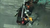 Aerials show Times Square car in flames