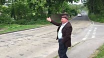 Man waves at village traffic