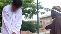Gay couple publicly caned under Sharia law