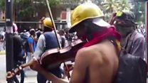 Venezuelan violinist plays amid protests