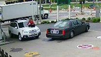 Americana surpreende ladrão e evita roubo ao se jogar sobre carro em posto de gasolina
