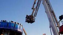 People stranded on broken funfair ride