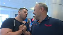Scarlets welcomed home at Cardiff Airport