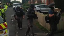 Armed police raid Manchester homes