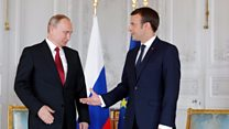 Macron greets Putin at opulent Versailles