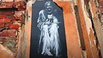 Artworks appear on derelict buildings