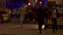 People flee scene with hands up