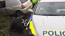 Drug dealer smashes into police car