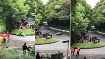Sidecar crew narrowly misses TT crowd