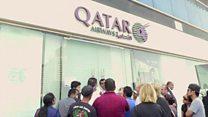 Qatar Airways passengers wait for news