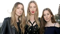 Haim explain how dinosaurs held up the follow-up to their debut album