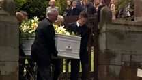 Knife attack mum and son buried together
