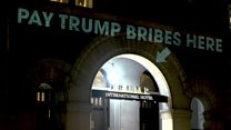 Who is behind the projections on the Trump Hotel?