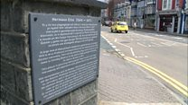 Plaque marks town's 'shameful' event
