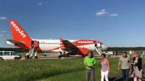 Plane evacuated after 'suspicious' talk