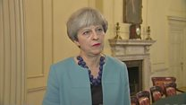 May promises 'proper investigation' into fire