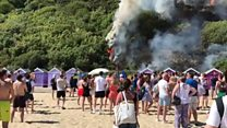 Bournemouth beach evacuated after fire breaks out in foliage behind beach huts