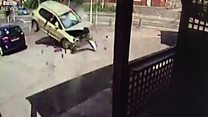 Watch: Car crashes near busy beer garden