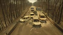 Drone footage shows Portugal fire cars