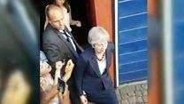 Theresa May booed at Grenfell visit