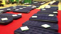 Air beds laid out in Swiss Cottage leisure centre