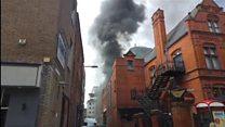 Black smoke rises from city car park
